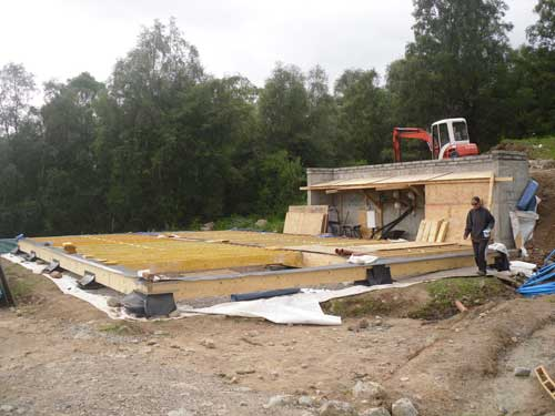 With the foundations in place, the main timber supporting beams are installed