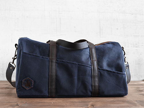 Uphill Designs - Cobalt waxed canvas duffel back - navy blue -front