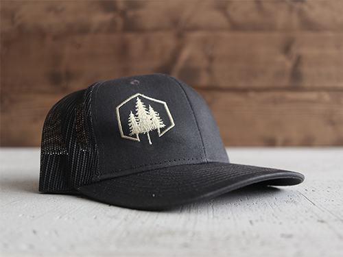 Uphill Designs - trucker hat - dark grey - green stitching - both designs