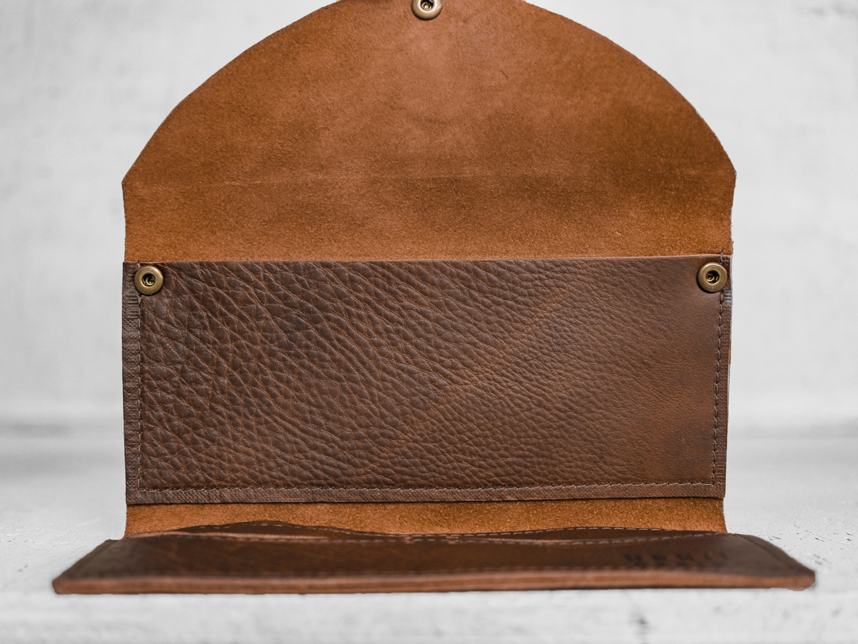 Uphill Designs - Annette leather and wallet clutch - sienna brown - in hands