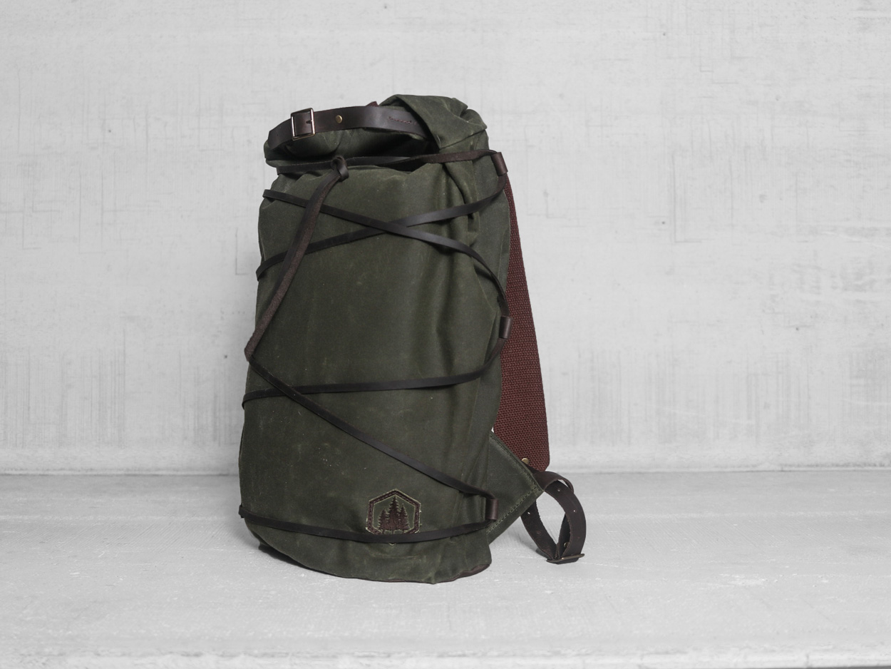 Uphill Designs - waxed canvas Divide rucksack - olive - front - tilted