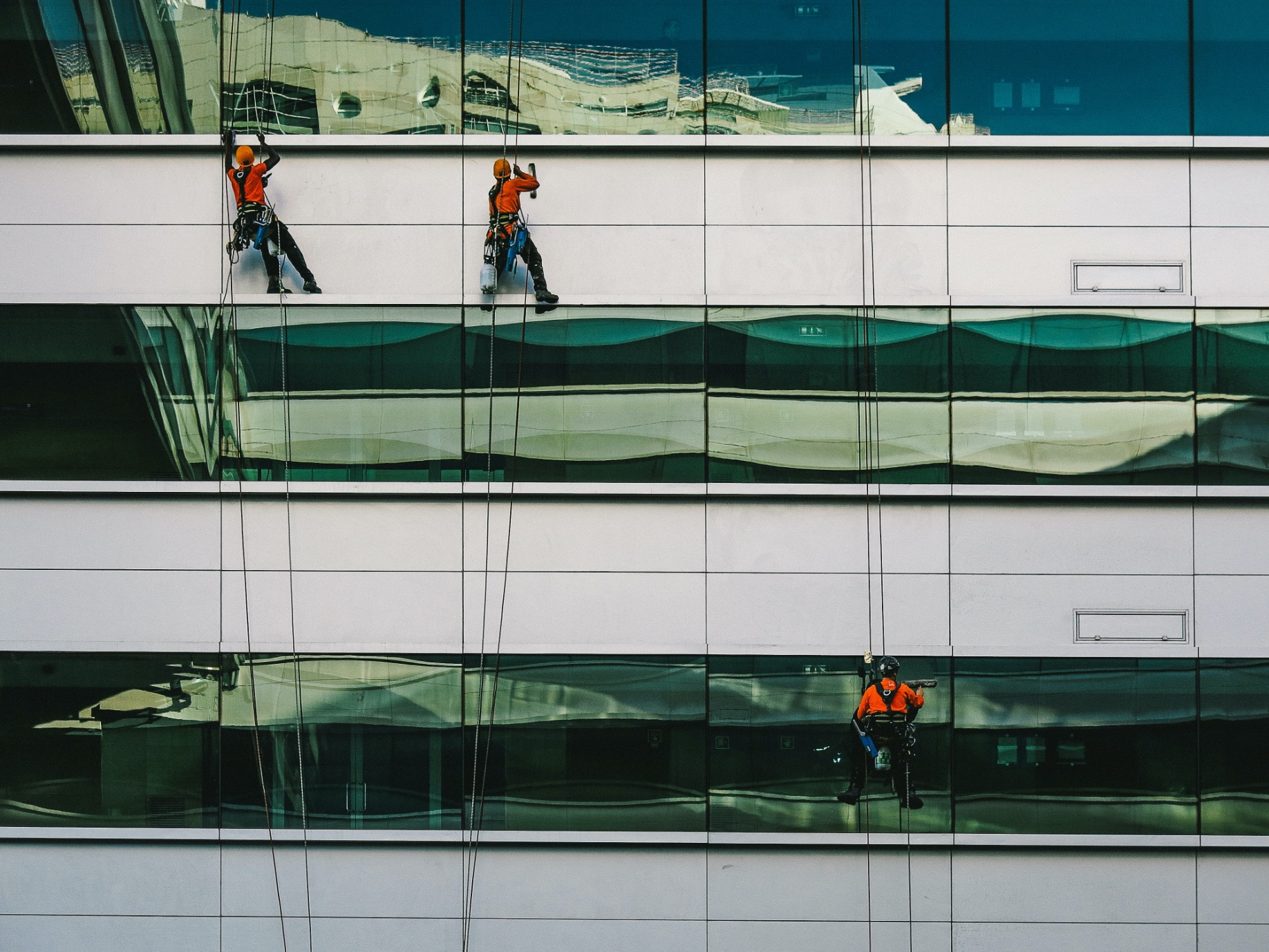 Maintenance crew cleaning a building