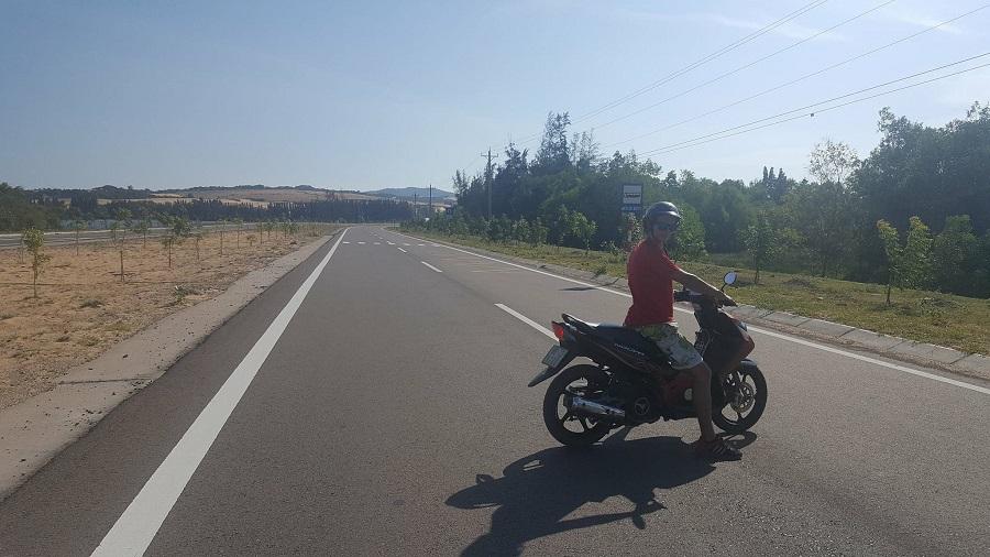 Riding moped in Mui Ne