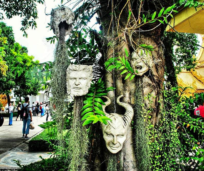 chiang rai white temple heads