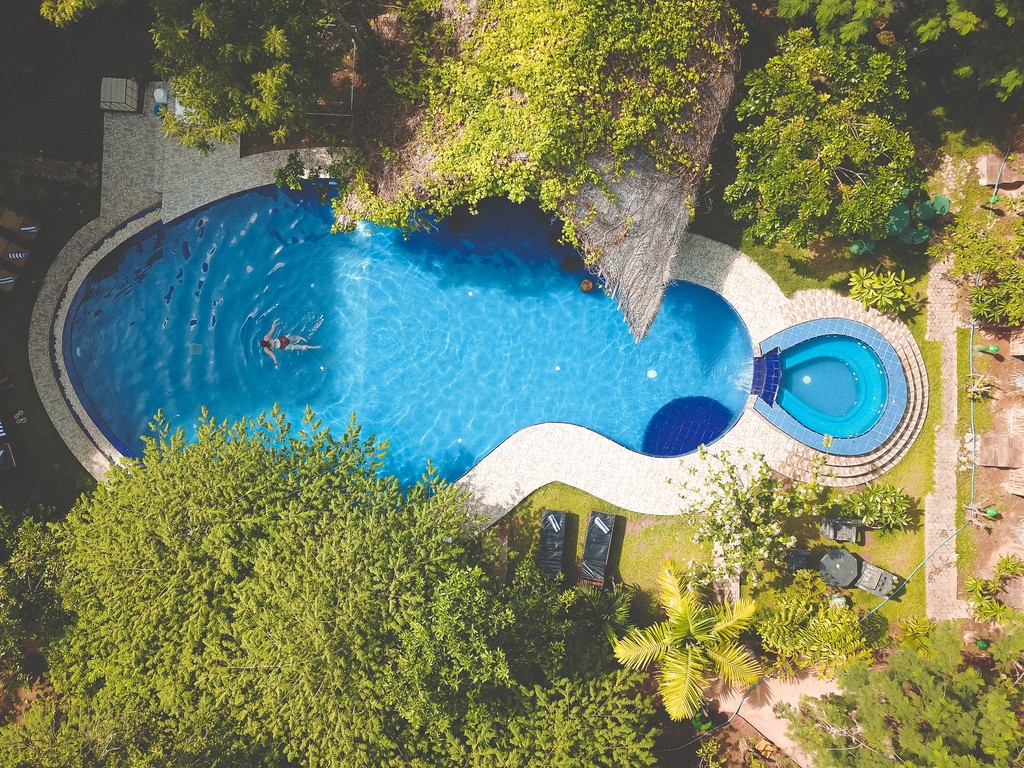 swimming pool at sundaras resort and spa