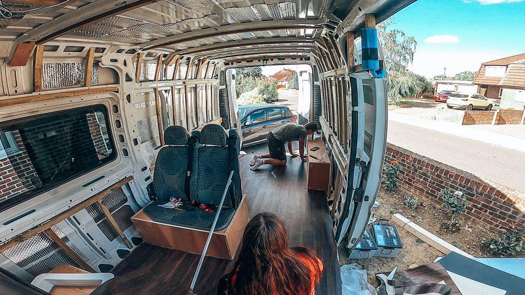 laying vinyl flooring in van
