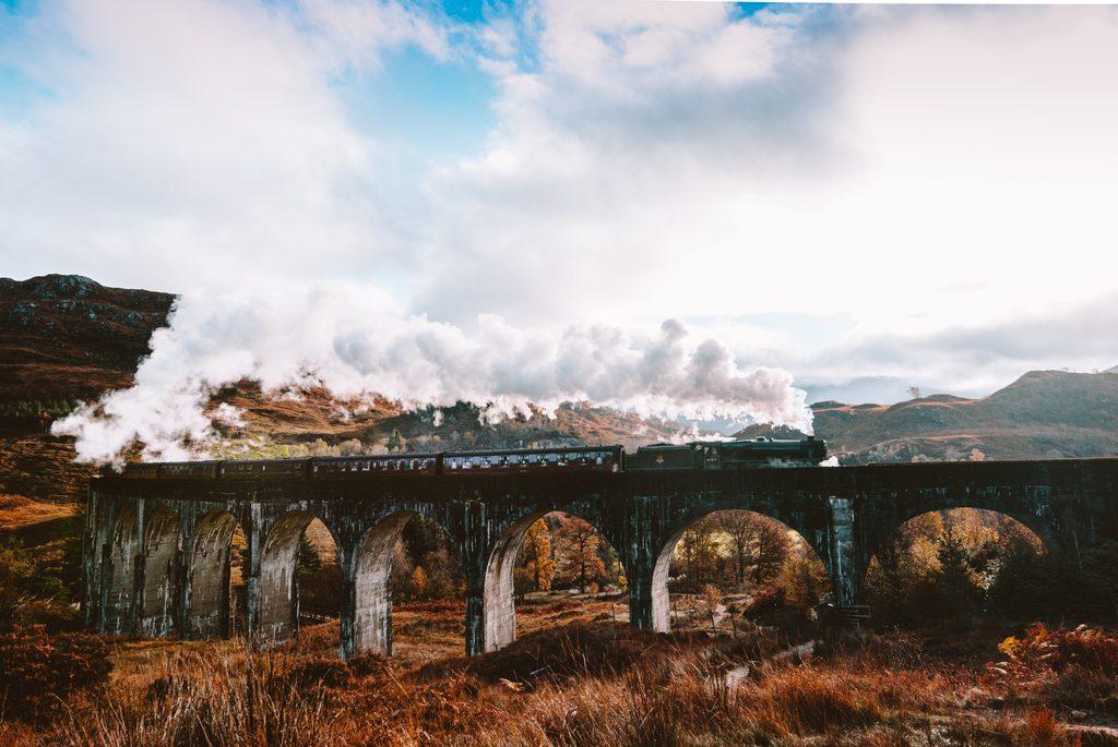 harry potter train going over glenfinnan viaduct