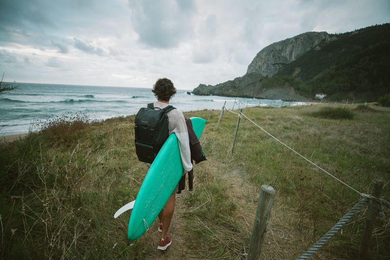 Surfing with Tropicfeel Shell backpack