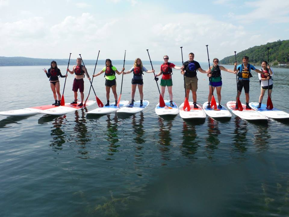 group of happy paddleboarders