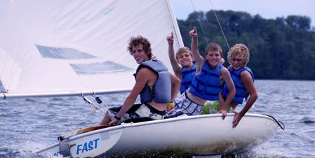 happy kids sailing
