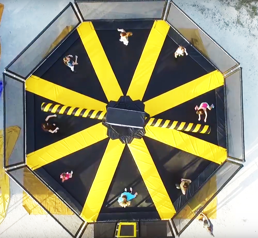 Image of people on the wipeout trampolines at Big Thrill Factory amusement park