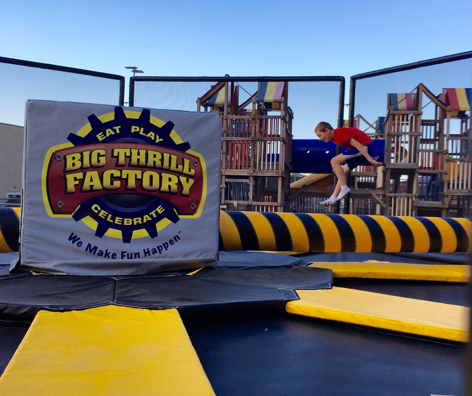 Image of people on the wipeout trampolines and axe throwing at Big Thrill Factory amusement park