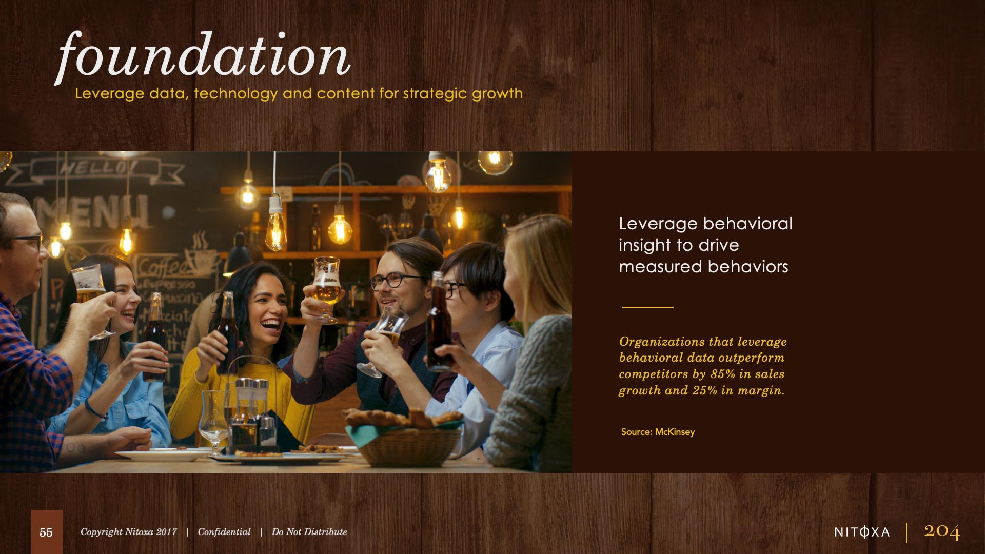 Slide design sample: slide showing group of 30-ish adults drinking beer around a table at the bar and grill.