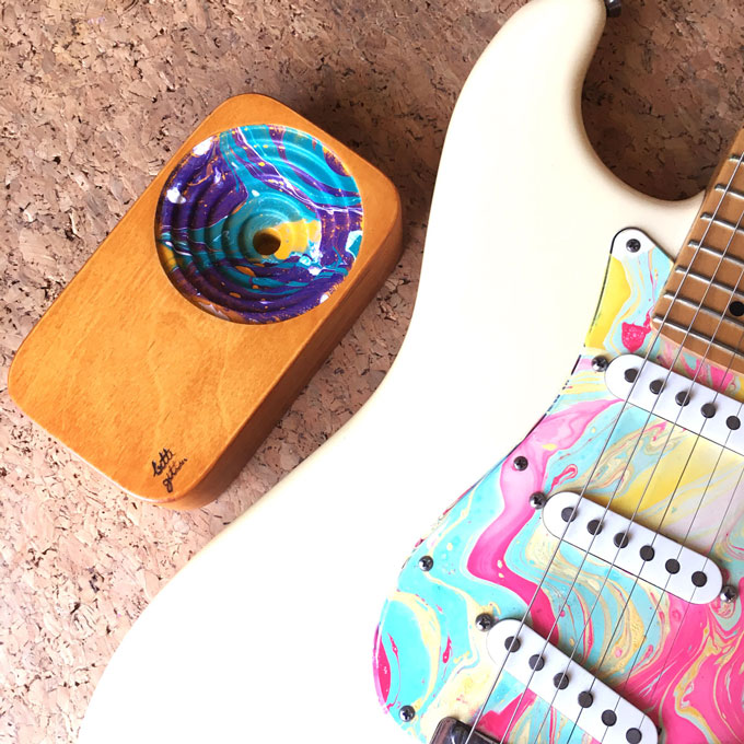 the wooden sound system with a guitar