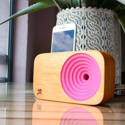 pink wooden sound system with a plant