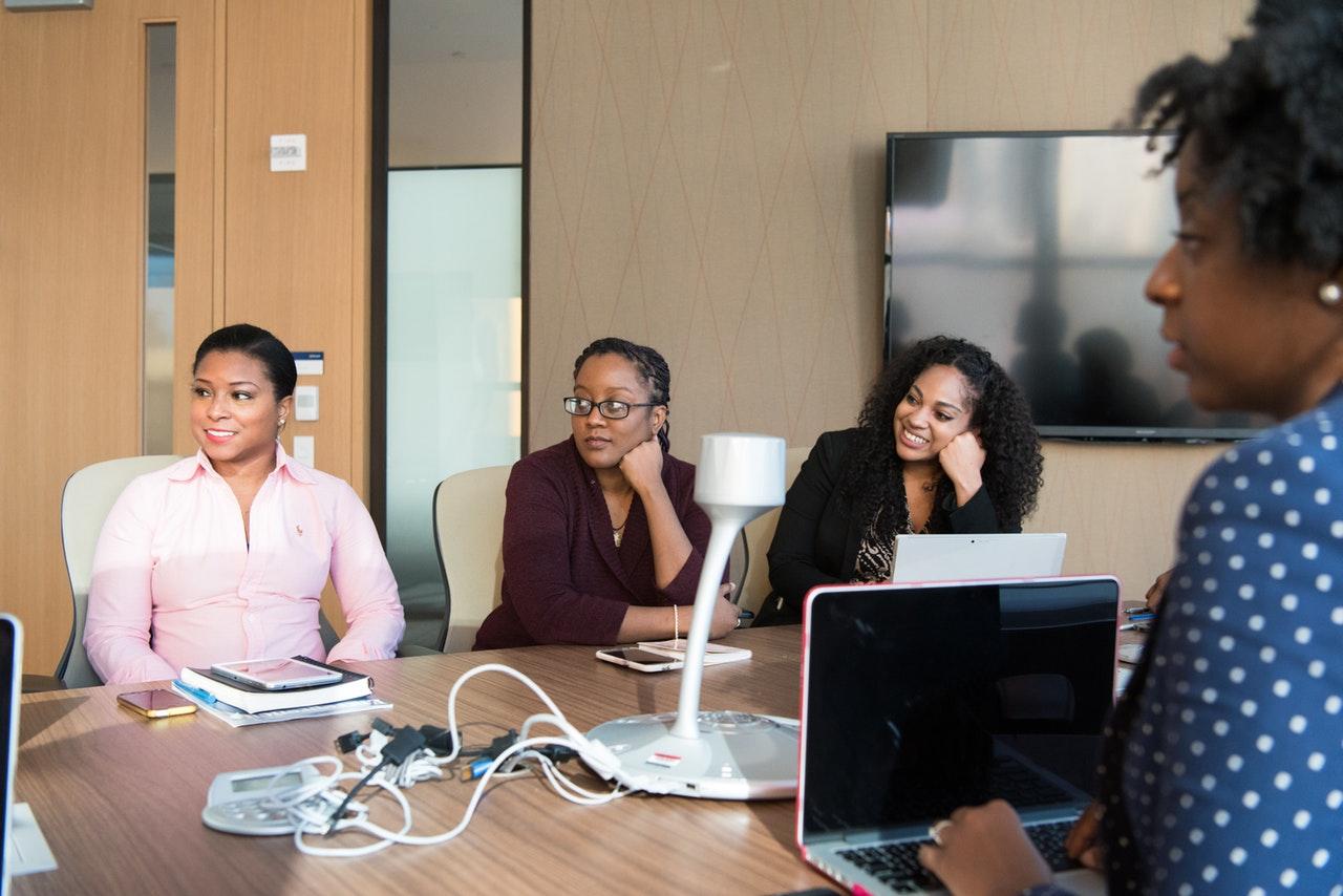 meeting of four black women