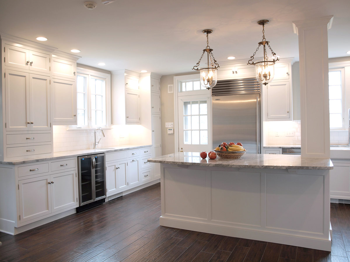 A kitchen with white cabinet