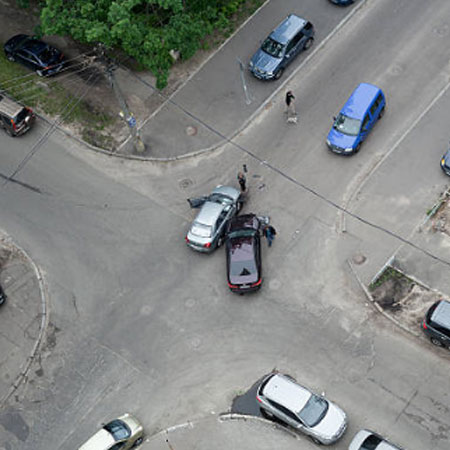 overhead view of car crash at intersection