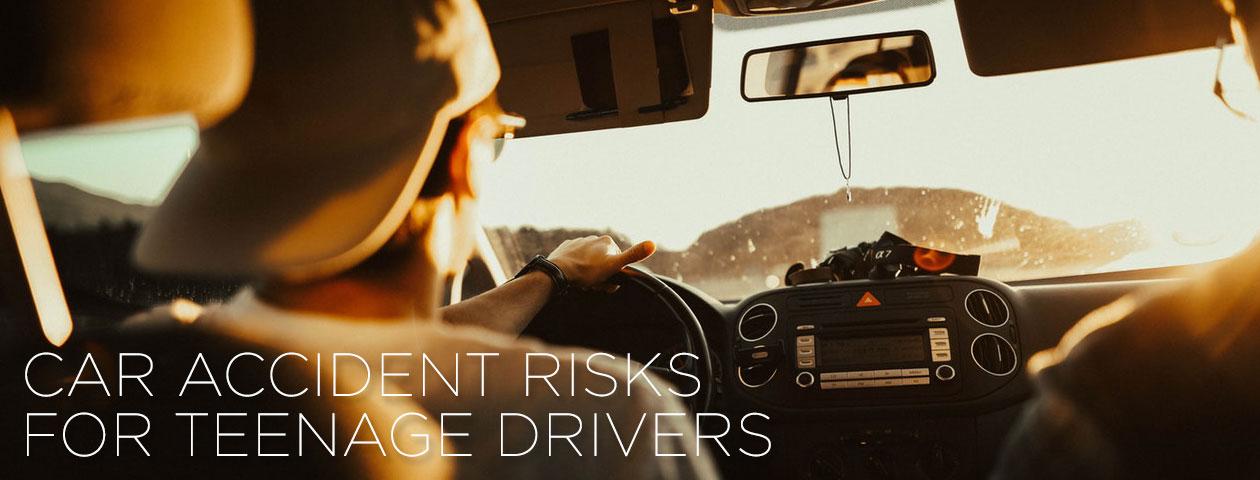 teenager behind wheel of car on the road