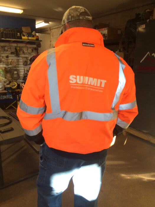 Summit snow removal employee