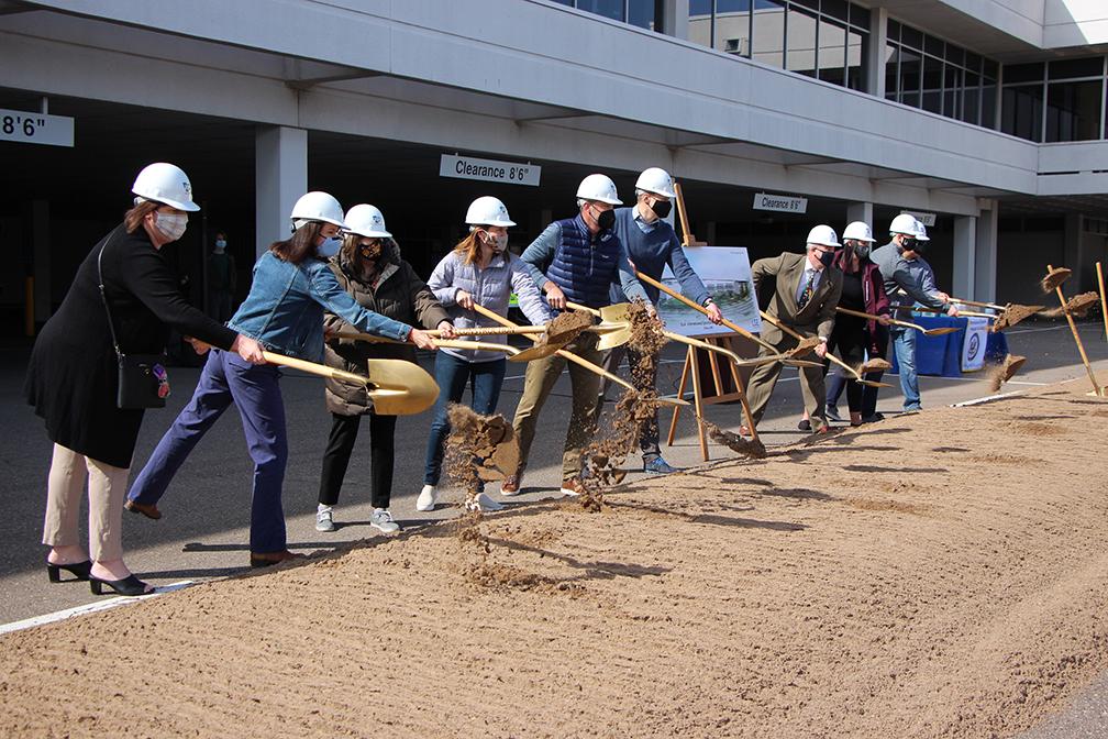 ISLA staff holding shovels at groundbreaking event