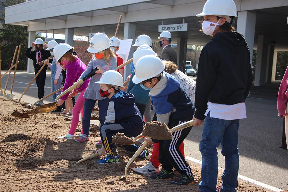 ISLA students holding shovels at groundbreaking event