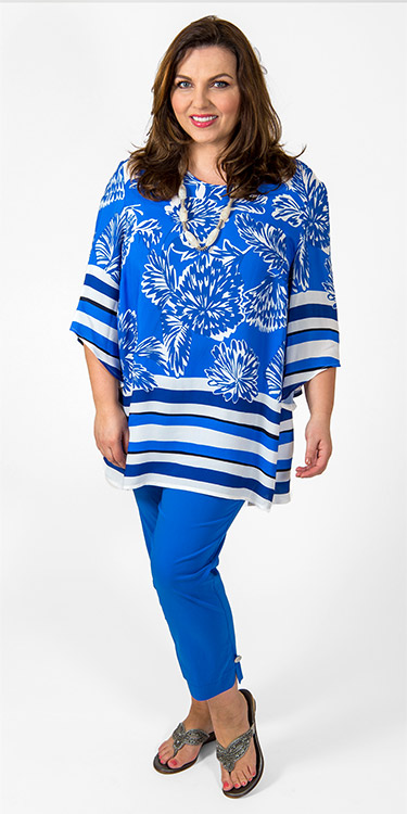 This model is wearing a gorgeous floral/striped tunic from Sempre Piu paired with their cornflower blue button feature stretch crop trousers. Perfect for summer barbeques! Available in plus sizes from Bakou