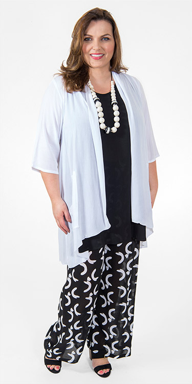 This model is wearing lightweight and striking palazzo trousers in black and white print from Angel Circle with their long crinkle vest in black and crinkle kimono in white