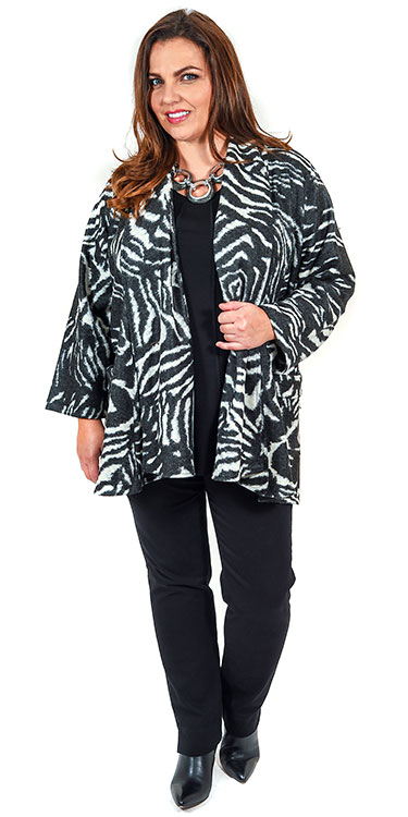 This model is wearing a fabulous zebra print edge to edge jacket from Kasbah with a Q'neel panel t-shirt in black and Robell pull on stretch jeans in black