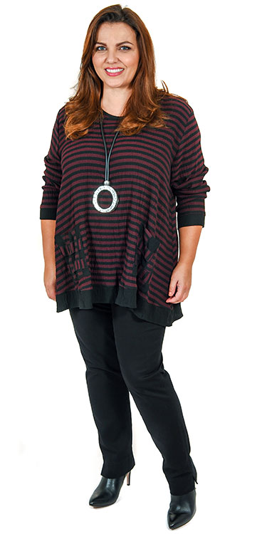 This model is wearing a striped tunic from Coom or Sinne in merlot/black stripe teamed with Robell black pull on stretch jeans