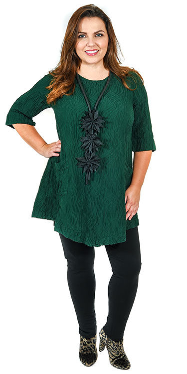 This model is wearing a gorgeous pine green tunic from Grizas teamed with Kasbah leggings in black