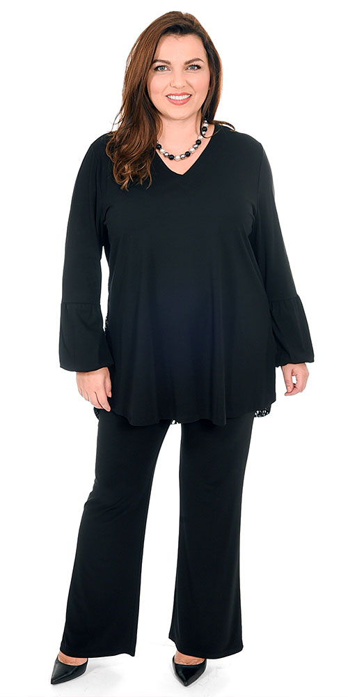 This image shows a model is wearing a gorgeous puff sleeve top from See You which has a stunning lace feature on the back teamed with Yoek silky jersey bootleg trousers in black. Sizes 14-30