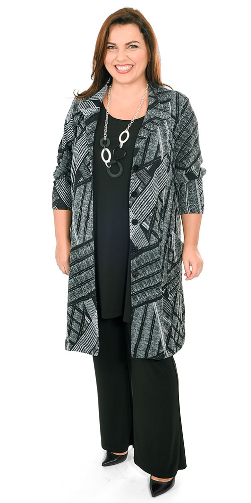 This image shows a model wearing a stylish long jacket from Carleoni teamed with Yoek silky jersey bootleg trousers and A line vest top. Sizes 14-30