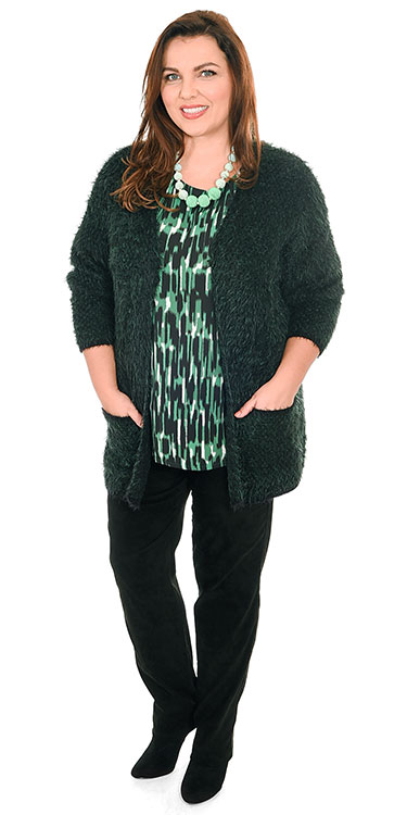 This model is wearing a gorgeously soft furry cardi in forest green from K J Brand over a K J Brand brushstroke top and Robell faux suede narrow trousers