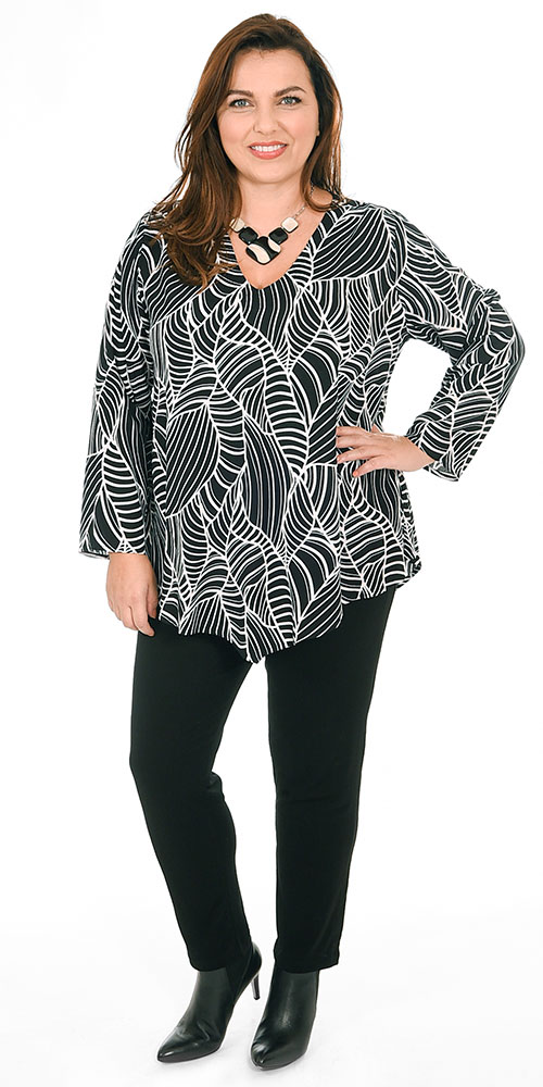 This image shows a model wearing a short v neck top by Angel Circle in black and white pattern teamed with Masai Pussa jersey stretch trousers
