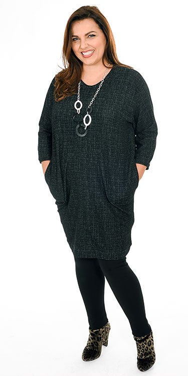 This model is wearing a Grussa long tunic/dress from Masai paired with Kasbah leggings in black
