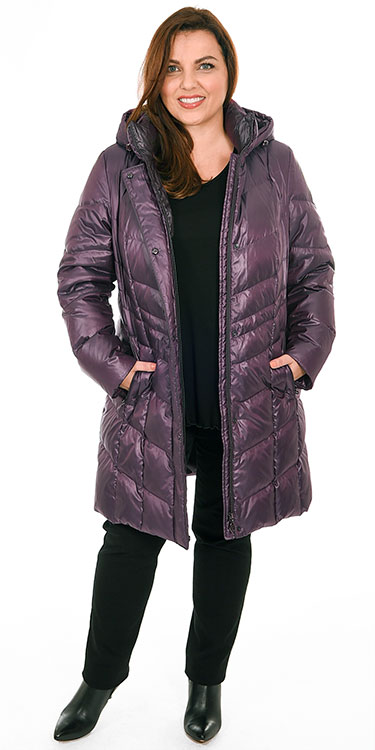 This model is wearing a gorgeous warm long puffa coat in purple from Frandsen, the coat specialists, over an Exelle long sleeved t-shirt and Robell super skinny super stretch Elena jeans