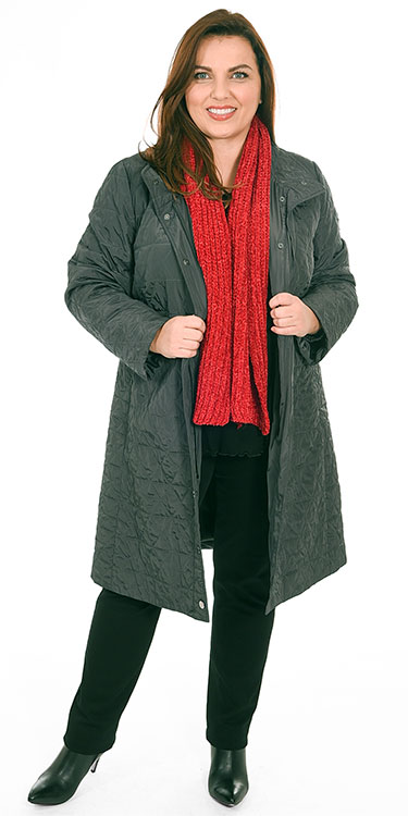 This model is wearing a light quilted coat from K J Brand over an Exelle long sleeved t-shirt and Robell Elena jeans with a gorgeously soft red scarf from a selection of accessories from Bakou in West Wimbledon for stylish plus size ladies fashion
