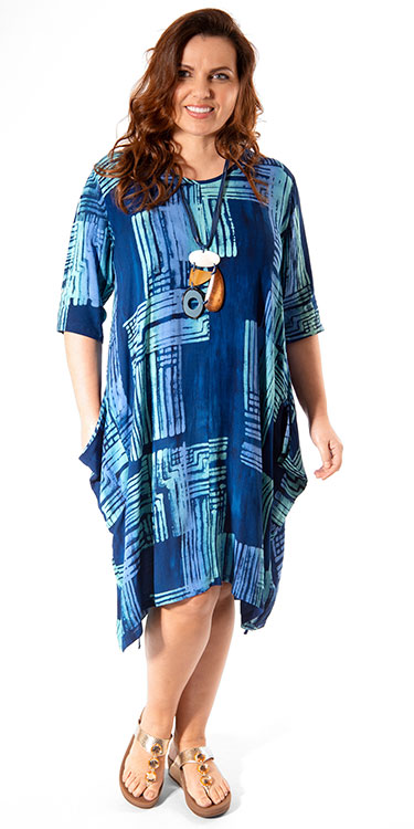 This model is wearing a loose dress, perfect for holidays, by Angel Circle teamed with a chunky necklace. Available in plus sizes from Bakou in West Wimbledon.