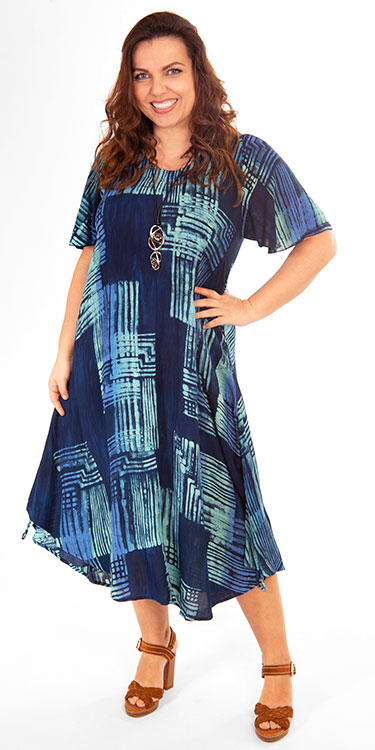 This model is wearing an elegant short sleeved dress by Angel Circle. Available in sizes 14-30 from Bakou.