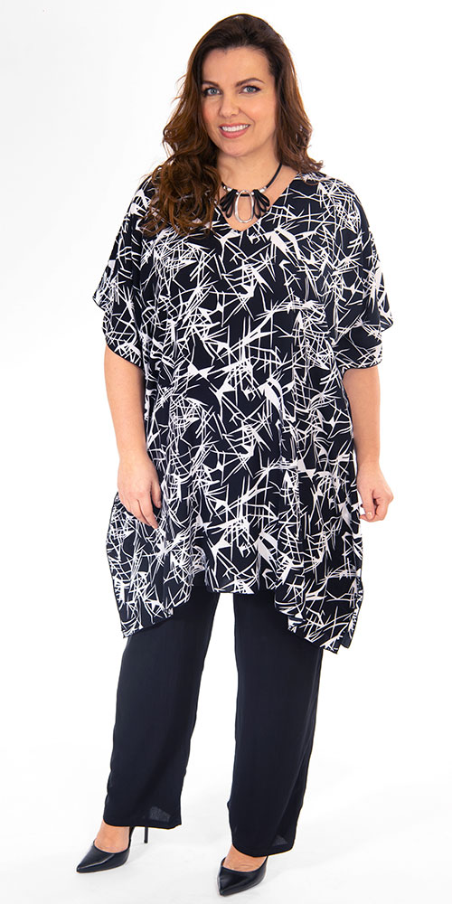 This image shows a model wearing a simple and stylish poncho style top from Angel Circle teamed with long crinkle trouses also from Angel Circle. Sizes 14-30.