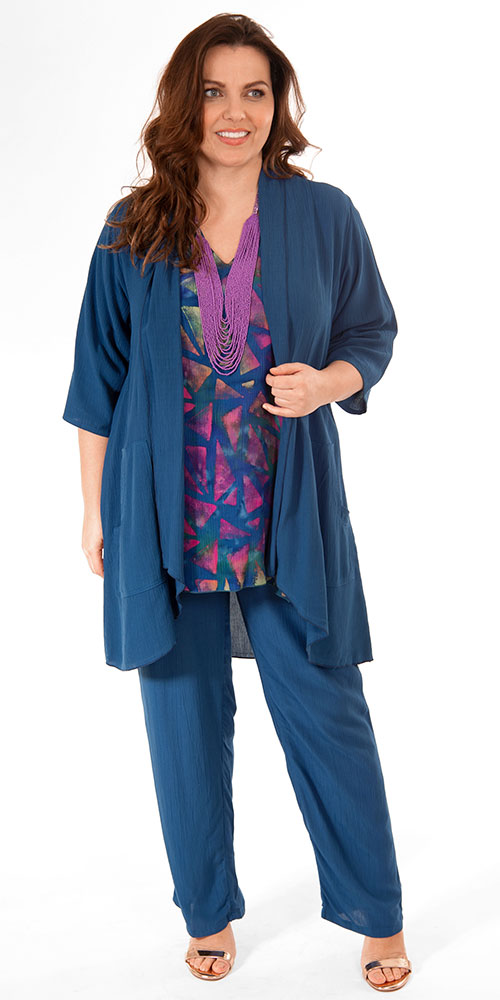 This image shows a model wearing a batik print tunic with pocket from Angel Circle teamed with nocturnal (French navy) kimono and trousers in crinkle viscose. All by Danish designers Angel Circle available in plus sizes from Bakou in West Wimbledon.