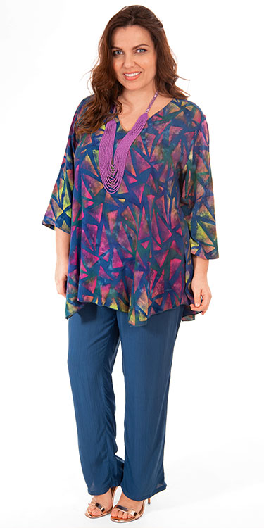 This model is wearing a batik print v neck tunic with pocket and crinkle viscose trousers from Angel Circle.