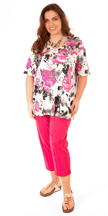 This model is wearing a pretty pink patterned t-shirt teamed with Wash & Go crop trousers from K J Brand. Plus sizes from Bakou.
