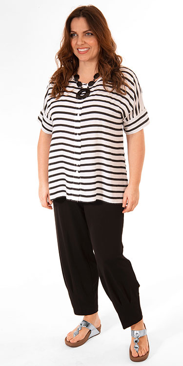 This model is wearing a Masai Lesha striped short sleeved shirt available up to size 22 paired with Q'neel jersey harem trousers in black.