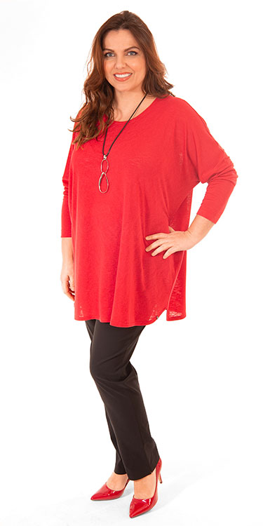 This model is wearing a fabulous coral modal jumper from Q'neel with Mona Lisa light weight narrow trousers in black.