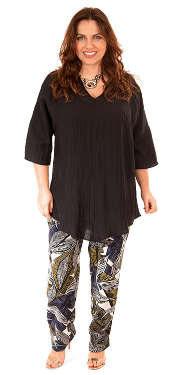 This model is wearing Q'neel leaf print trousers with a black v neck tunic from Doris Streich. Plus sizes from Bakou in West Wimbledon