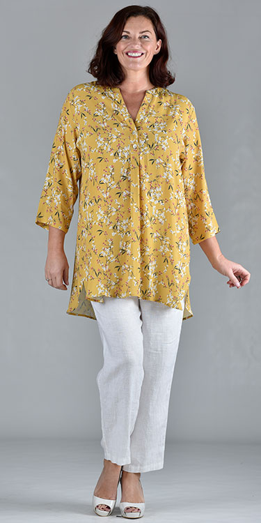 This model is wearing a stunning saffron floral print tunic from Moroccan based Kasbah Clothing. Available from Bakou in West Wimbledon for plus sizes.