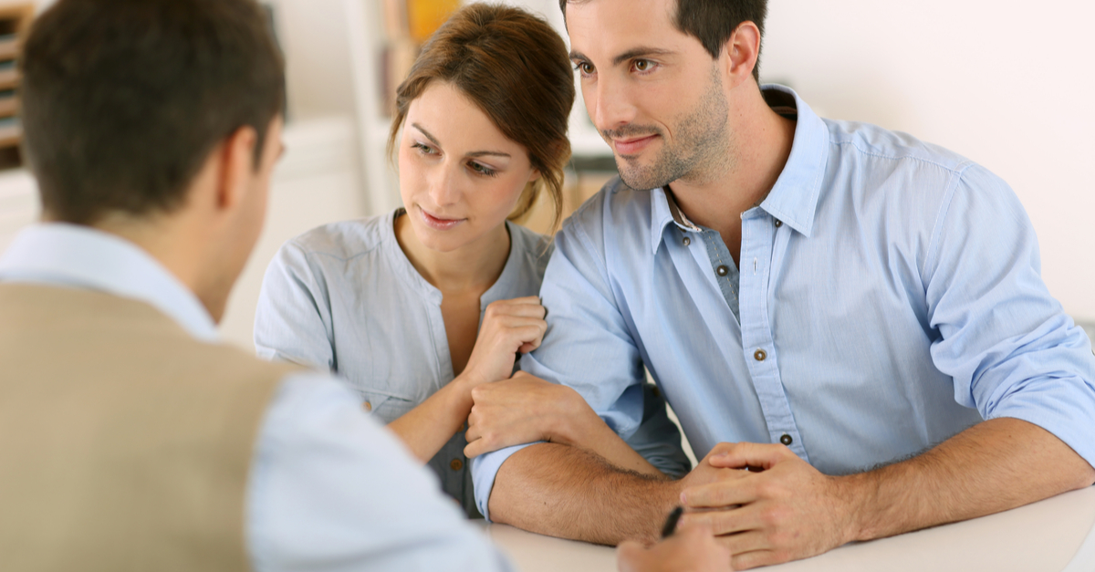 Couple talking at table with professional