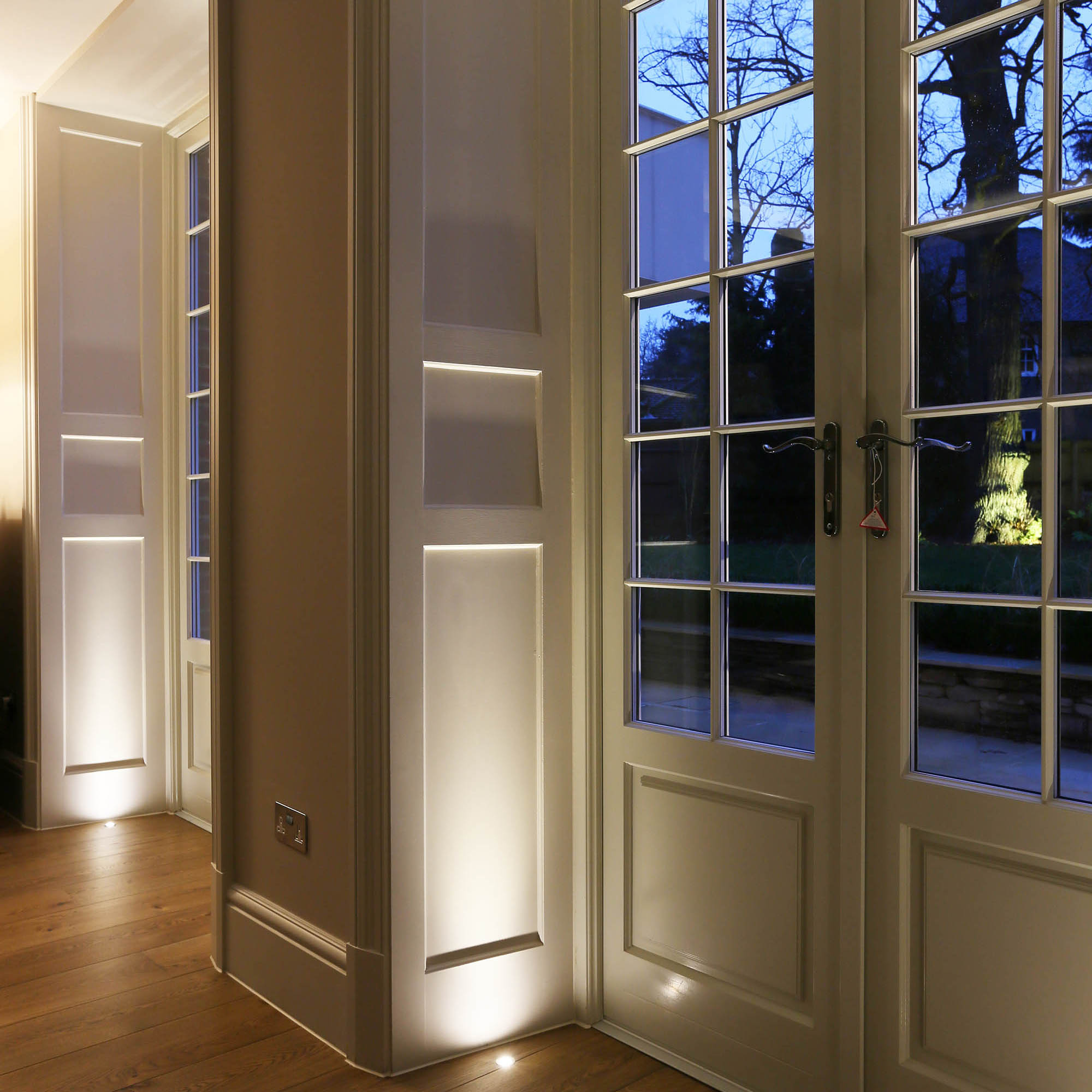 French doors with uplighting for luxury Surrey House renovation